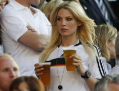Sarah Brandner carries beers before the Euro 2008 quarter-final soccer match between Portugal and Germany in Basel
